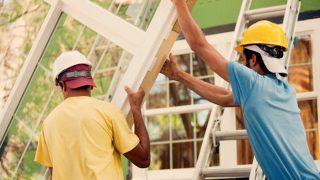 2 men installing windows