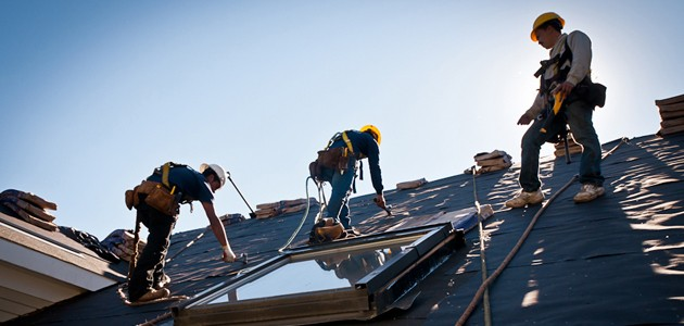 roofing crew installing shingles