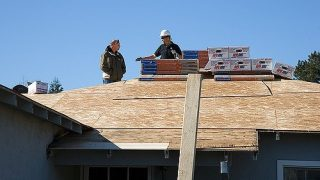 Roofing Contractor at Work in Frisco, TX