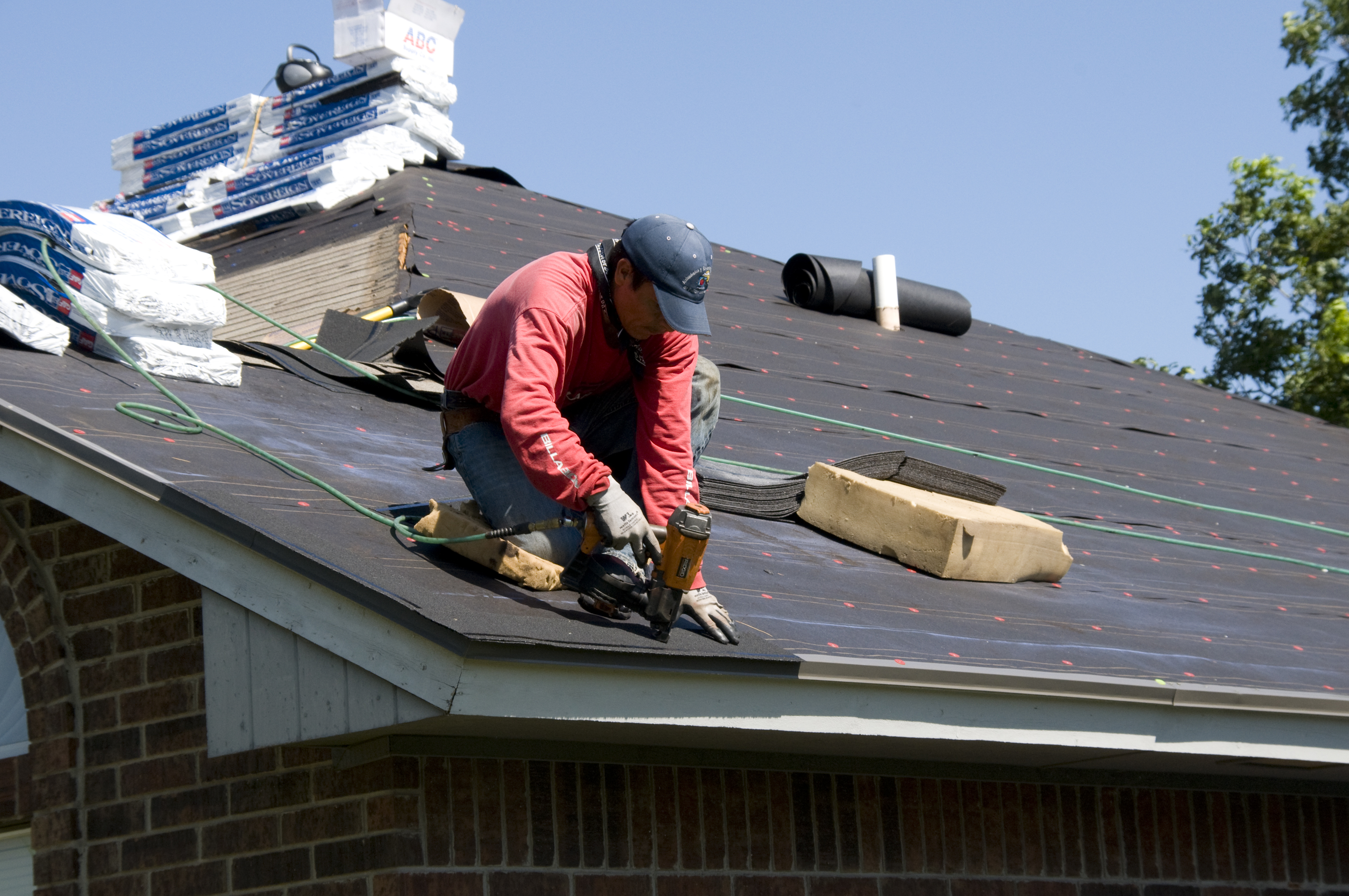 Roofer Doing a Roofing Replacement in Frisco, TX
