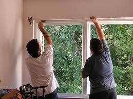 window contractor installing a window