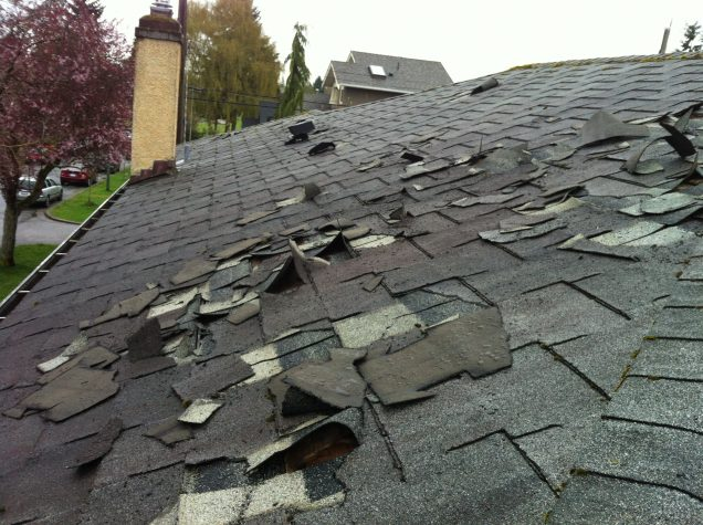roof that has been damaged by a storm